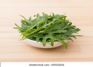 White porcelain bowl with lettuce salad