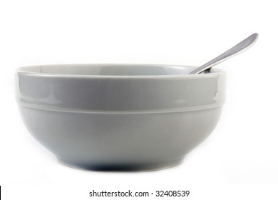 white porcelain bowl with a spoon isolation on a white background