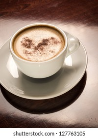 White porcelain cup of freshly brewed coffee