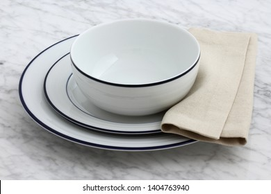 white porcelain dishes with classic blue borders an staple in Parisian bistros and brasseries