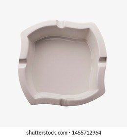 White porcelain empty ashtray isolated on white background. Ceramic simple square and modern shape ashtray for your product or smoking ad.