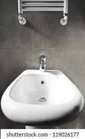 White porcelain entire bidet and heater