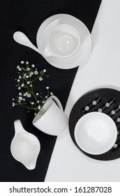 "White porcelain on black and white linen tablecloths.  Abstract still life. From series ""Playing with Color"""