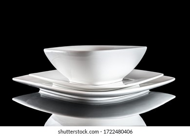 White porcelain plate on table. Dinner background. Empty round round isolated on black background. Restaurant kitchen minimalistic concept.