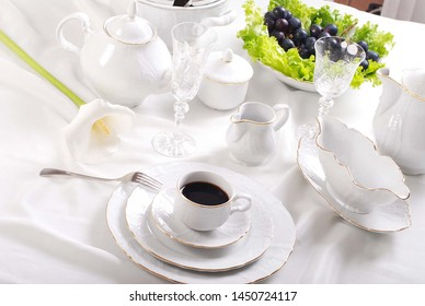 White porcelain tableware with a simple golden rim design