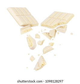 White porous chocolate broken into pieces in the air