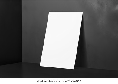 White Poster Mockup on black background with a reflection