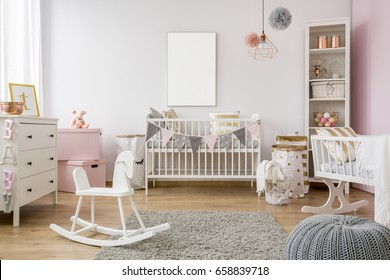 White poster mockup over crib in pastel baby room