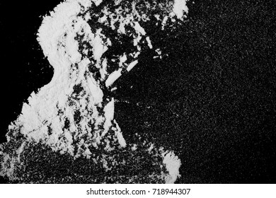 White powder isolated on black background, top view