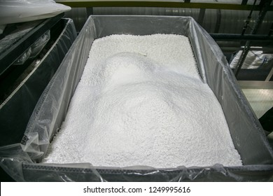 White powder thermoplastic polymer in storage tank