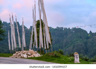 White prayer flags on roadside in Bhutan guiding those who had perished