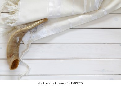 White Prayer Shawl - Tallit, and Shofar (horn). Jewish religious symbols