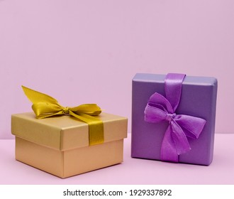 White present with red ribbon on the bright red background . Festive backdrop for holidays: Birthday, Valentines day, Christmas, New Year.