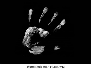 White print of a human hand with fingers splayed. Hand print isolated on black background.