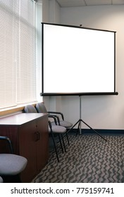 White projector screen in the meeting room