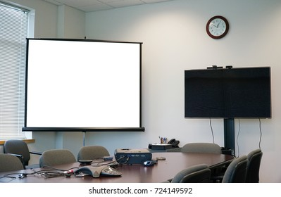 White projector screen and monitor in the meeting room