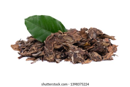 White puer tea, isolated on white background. Chinese tea Puer. Pressed fermented Pu-erh tea. Macro close up. Aromatic green puer tea. Healthy drink.