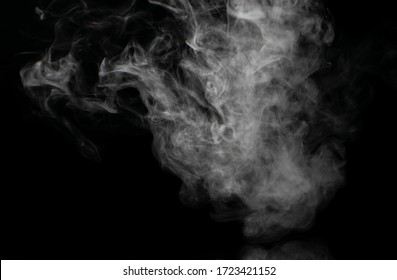 White puffs of smoke on a black background float mixing in bizarre chaotic patterns of thin threads
