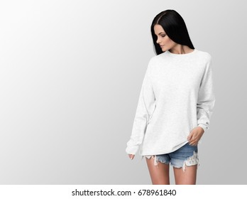 White pullover on a young woman in shorts, isolated, with copy space, mockup.