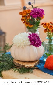 white pumpkin with flowers, festive autumn table
