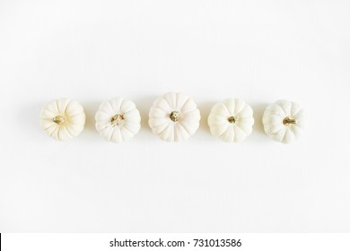 White pumpkins. Fall autumn minimal concept. Flat lay, top view. Christmas background. White pumpkins background.