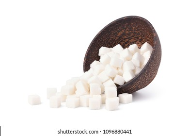 White pure sugar cubes in wooden bowl isolated on white background
