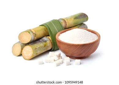 White pure sugar in wooden bowl with fresh sugarcane and sugar cubes isolated on white background