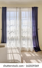 White and purple curtain in living room