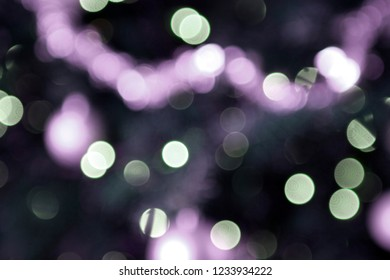 White and purple lights as holiday background