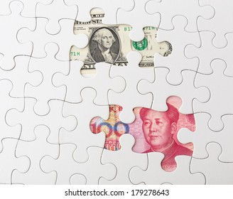 White puzzle with American dollar and chinese yuan