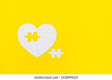 White Puzzle Heart Shape With Missing Piece, On Yellow