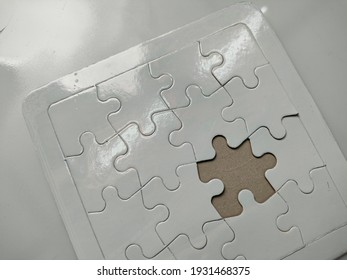 white puzzle jigsaws concept with magnifying glass see on empty space puzzle jigsaws