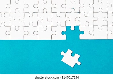 White puzzle pieces and place on blue background for your content.