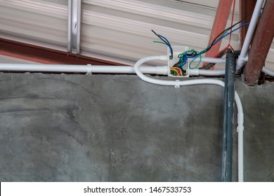 White PVC plastic electrical boxes and wires buried in to the roof.