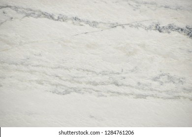 White quartzite stone with natural pattern texture background.