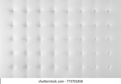 White quilt for mattress