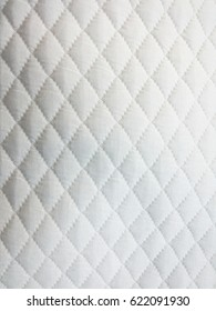 White quilted fabric background texture