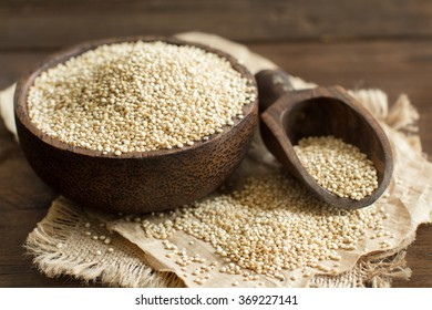 White Quinoa in a bowl with a wooden spoon close up