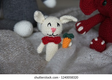 White rabbit finger puppet holding carrot