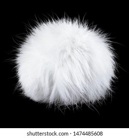 White rabbit fur pompom on black background