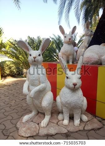White Rabbit Statues In Garden. Animal Sculpture In Zoo.