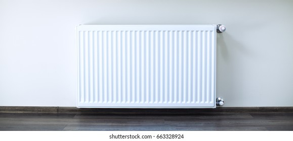 White radiator in an apartment. Radiator.