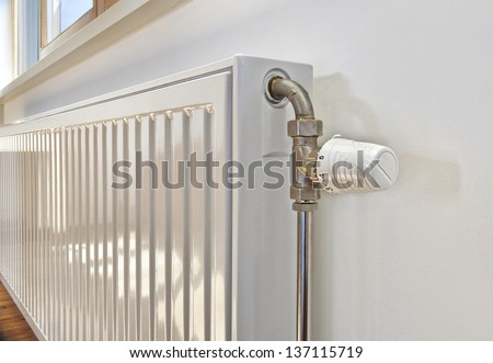 White radiator in an apartment.
