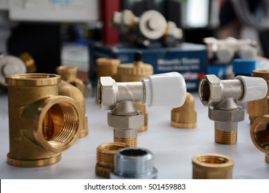 white radiator valves and brass fittings used for radiators in plumbing and heating systems