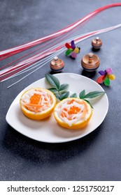 White radish and carrot pickles in hollowed out yuzu citron for japanese new year food