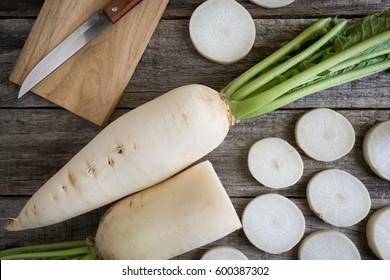 White radish sliced on wooden table.
