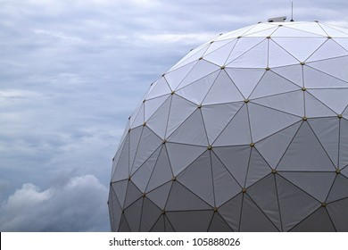 White radome covering sensitive tracking equipment at Kennedy Space Center is shot against a darkening Florida sky.