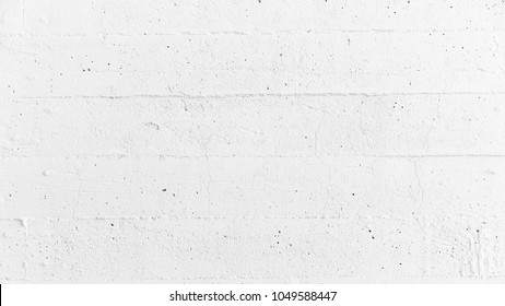 White ragged, rough wall concrete background.