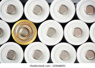 White rechargeable batteries and a rusty one