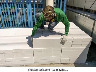 White rectangular bricks, including decorative brick on an outdoor pallet.